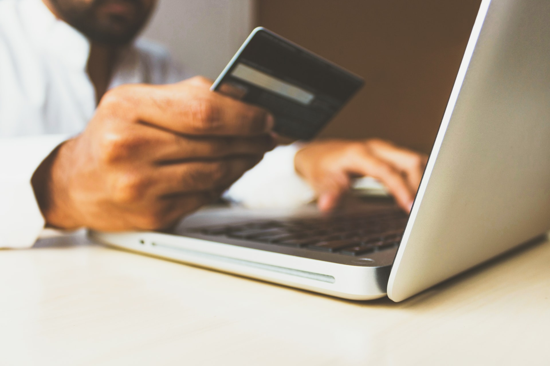Online shopping on laptop computer with credit card.