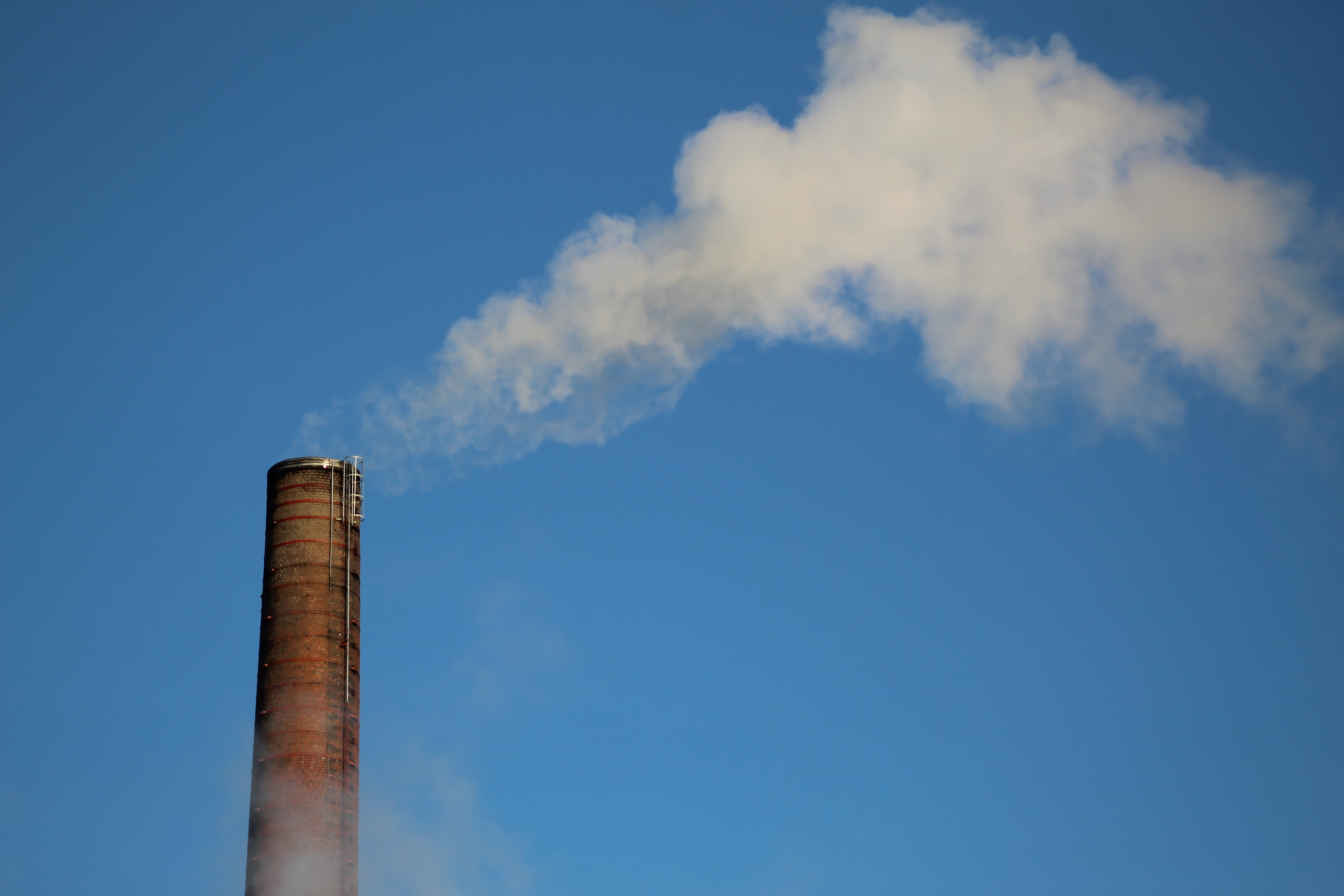 Manufacturing silo producing steam cloud